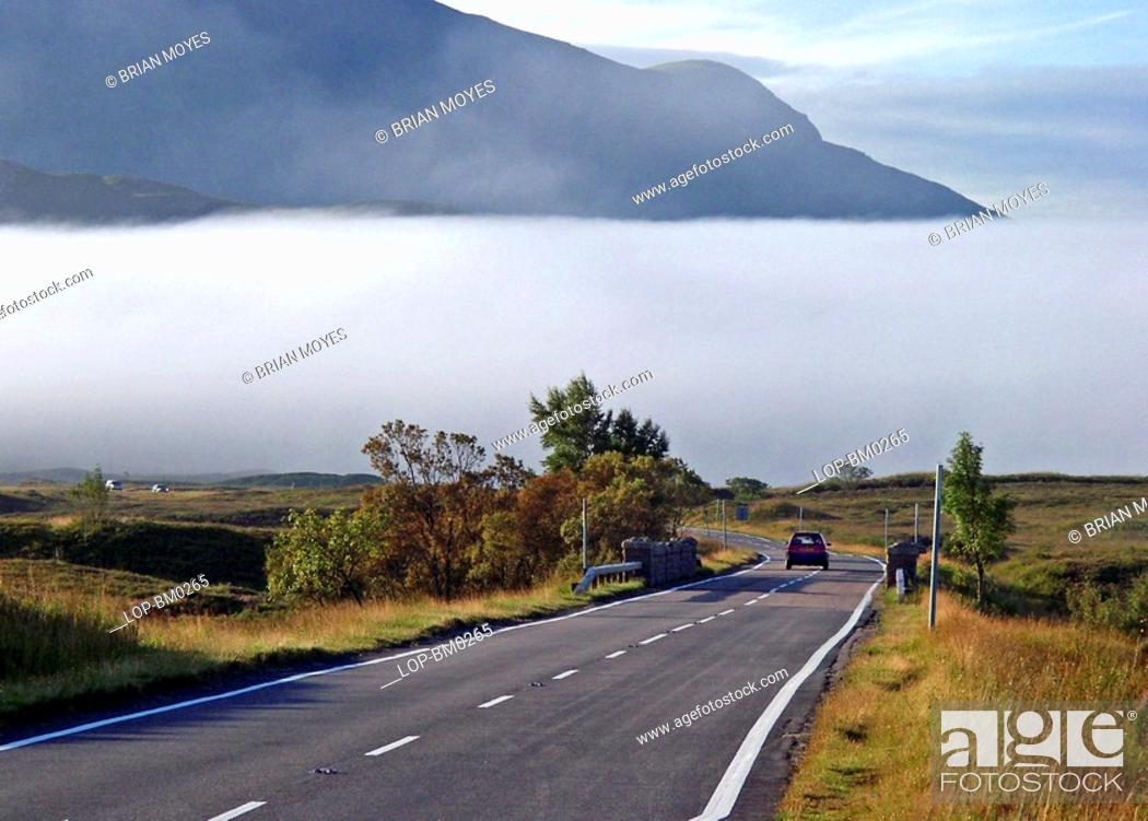 Stock Photo: Scotland, Highland, Fort William, Highland road with mist and mountains.