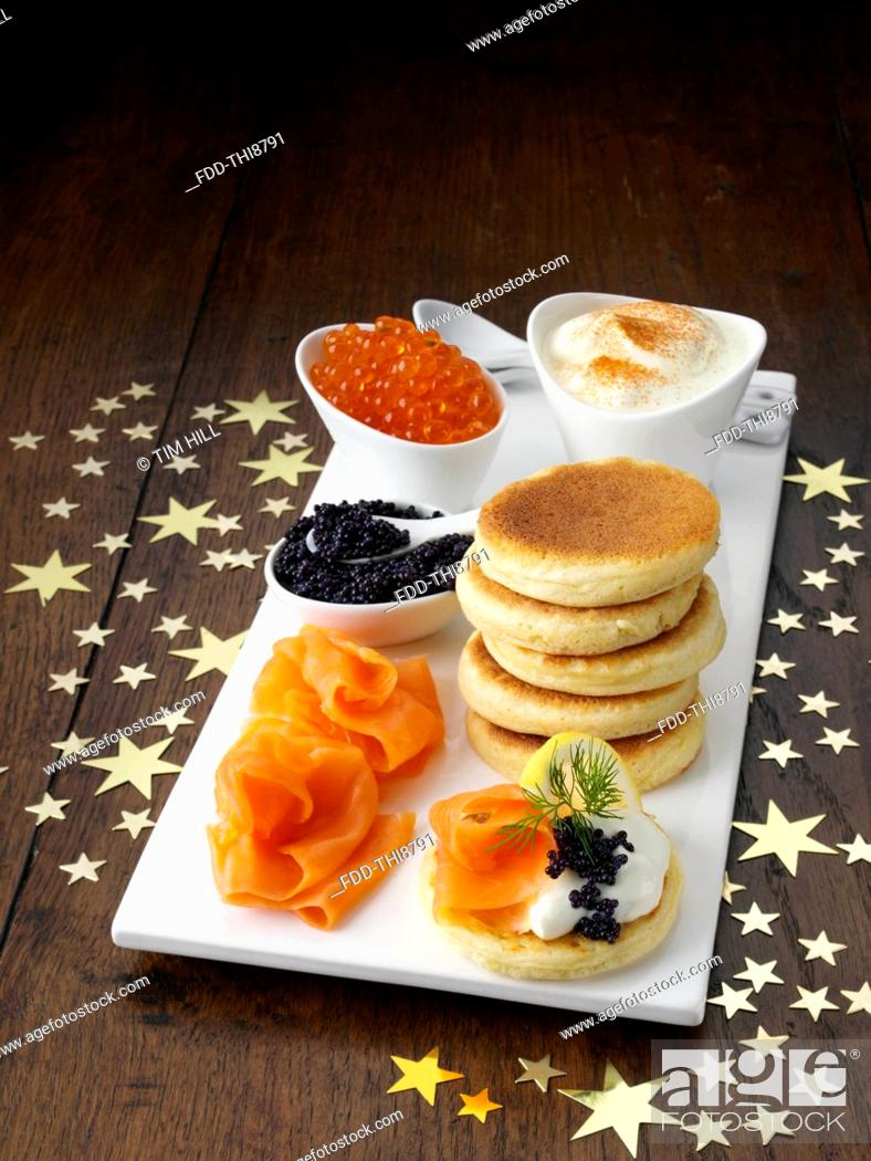 Imagen: Blini with smoked salmon salmon roe and sour cream.