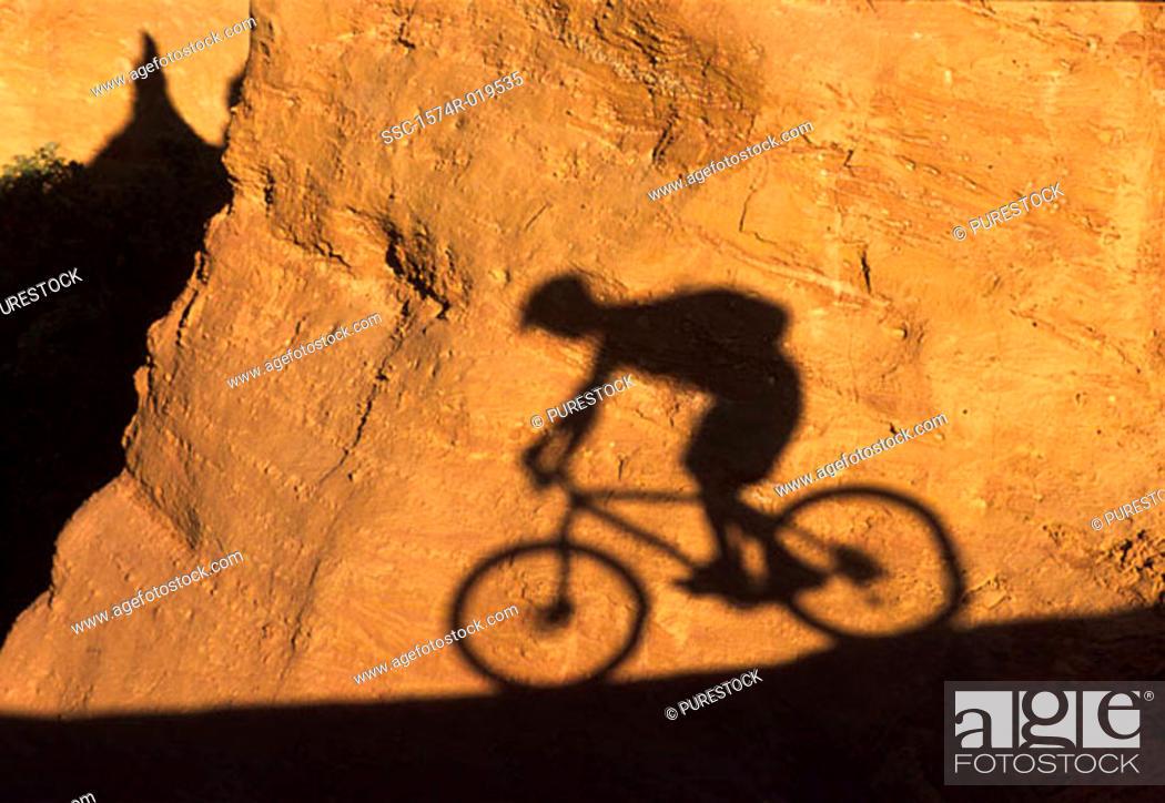 Stock Photo: Shadow of person mountain biking.
