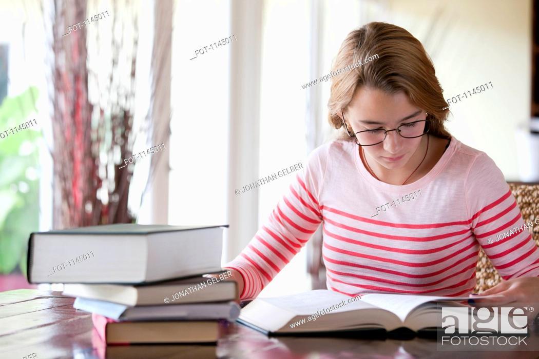 Stock Photo: Busy girl doing homework.