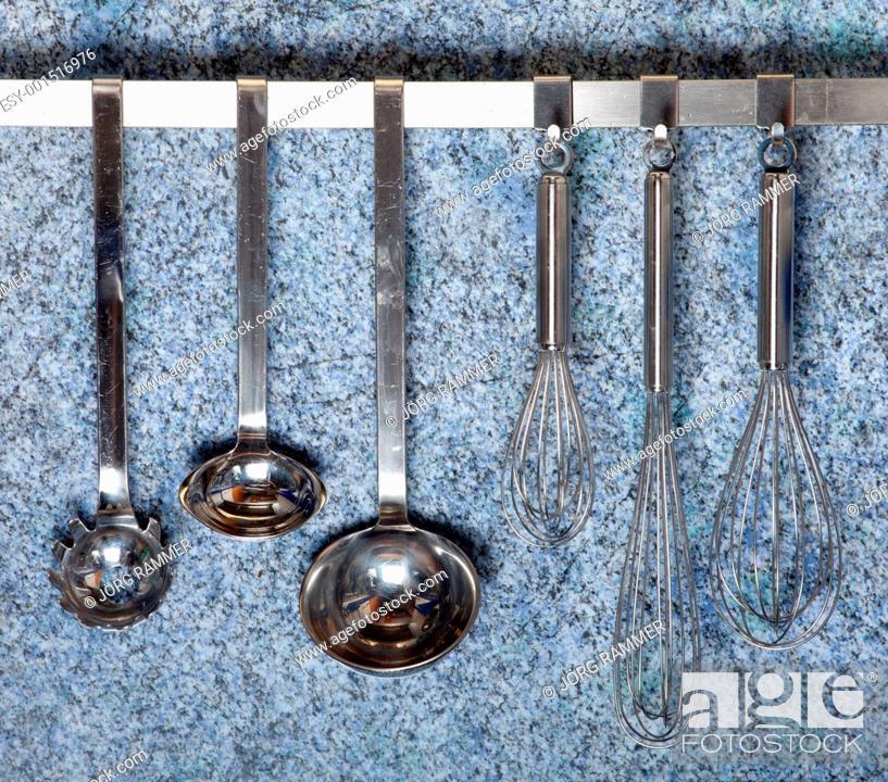 Stock Photo: kitchen tools hanging.