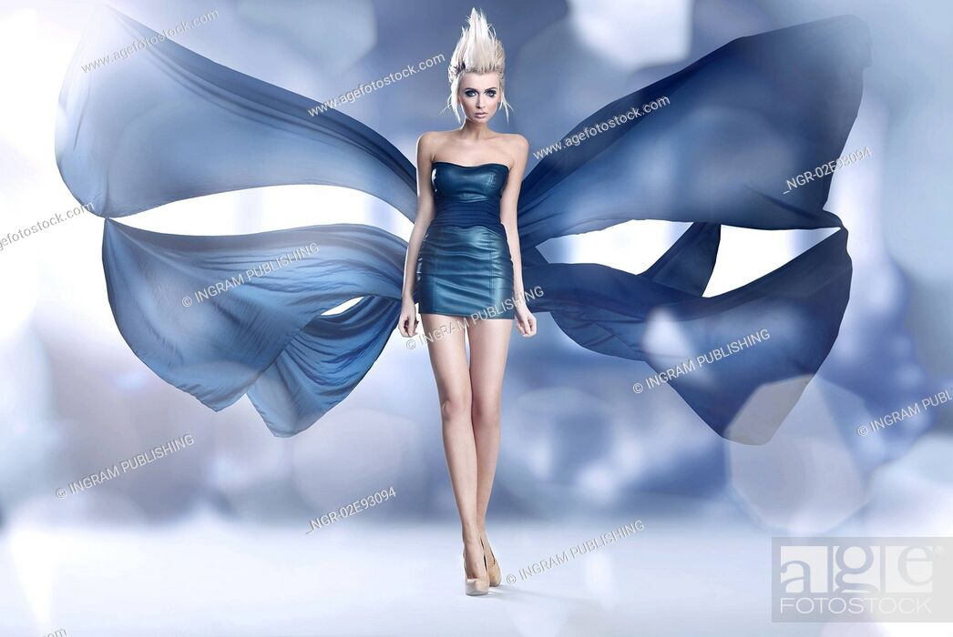 Stock Photo: Beautiful woman as an amazing butterfly in blue dress.