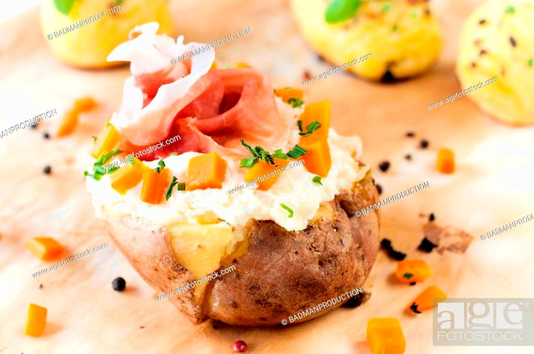 Stock Photo: Fresh baked potato and prusciutto with white cheese cream.