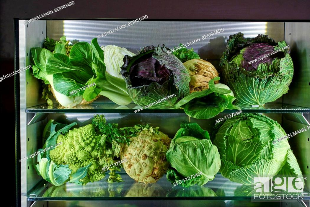 Stock Photo: Cabbages, leafy greens and root vegetables.
