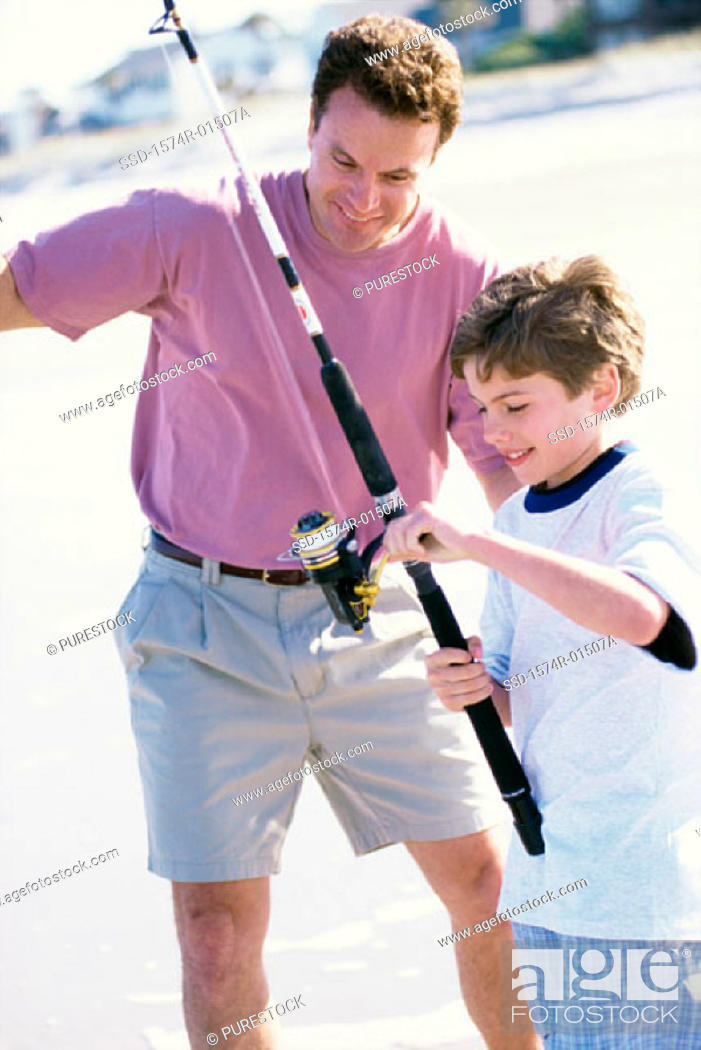 Stock Photo: Father and son fishing on the beach.
