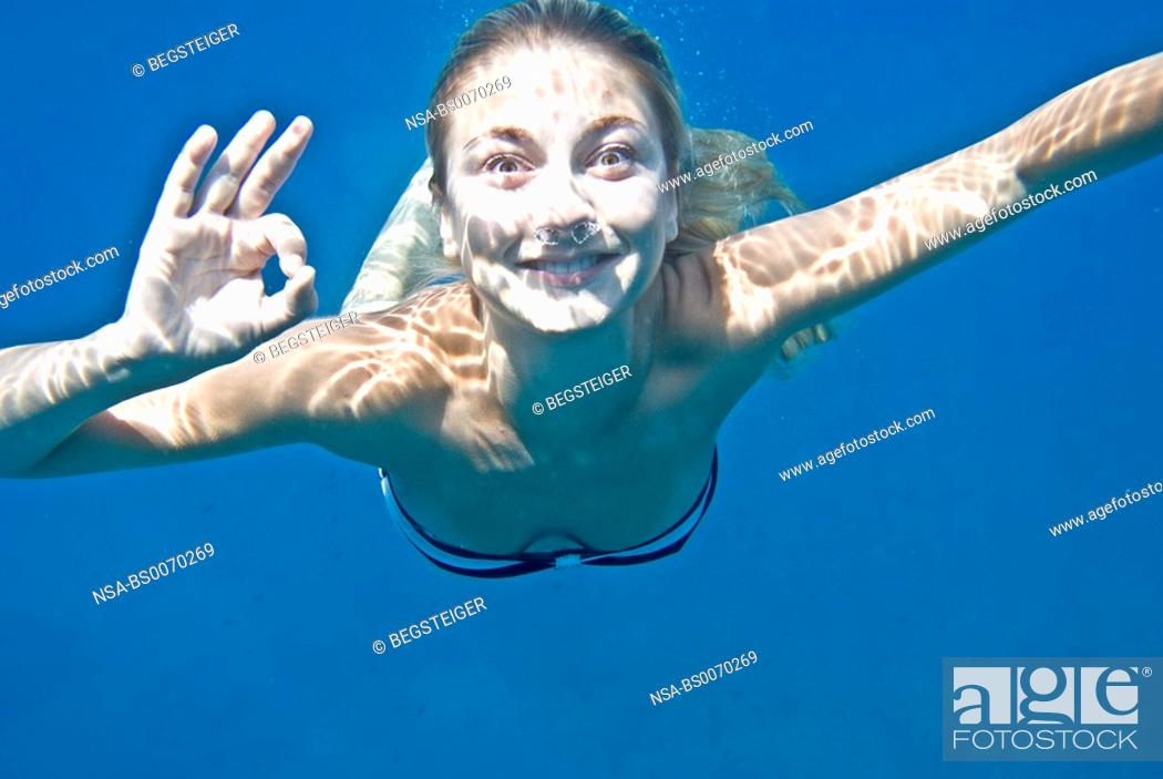 Stock Photo: young woman under water.