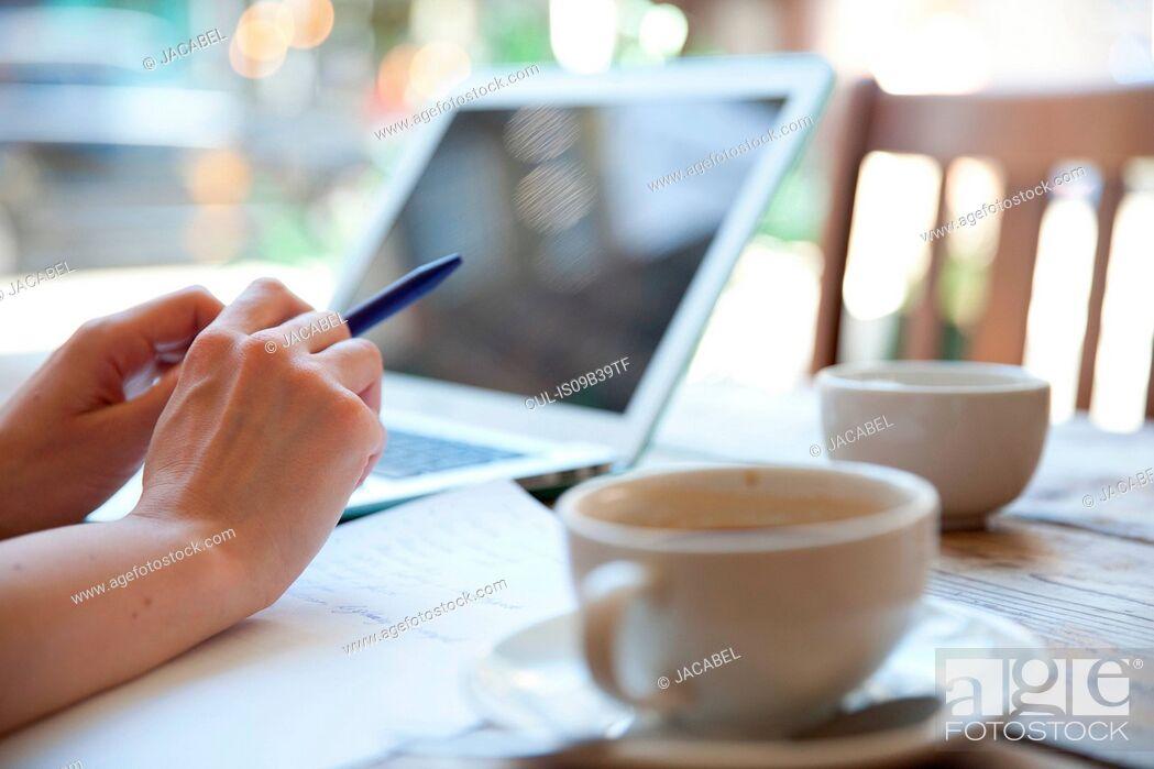 Stock Photo: Businesswoman having meeting in coffee bar, London.