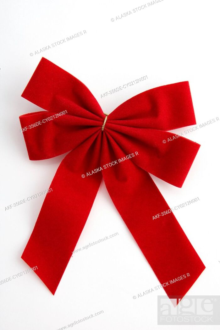 Stock Photo: One red traditional Christmas bow on white background studio portrait.