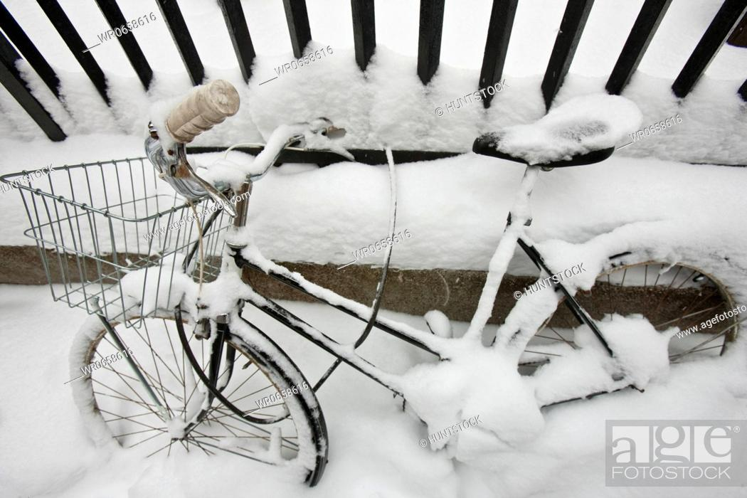 Stock Photo: Bicycle covered with snow, Beacon Hill, Boston, Suffolk County, Massachusetts, USA.