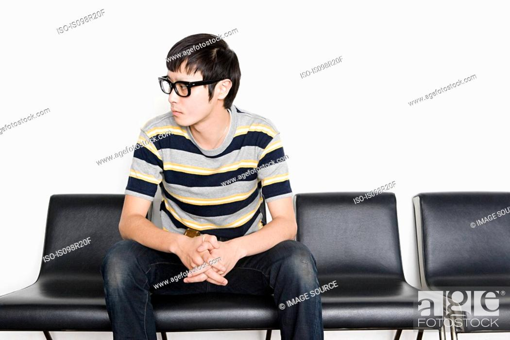 Stock Photo: Young man looking away.