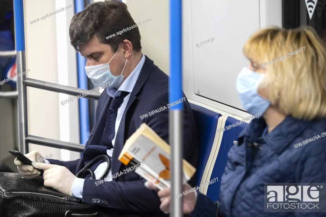 Stock Photo: (200512) -- MOSCOW, May 12, 2020 (Xinhua) -- Passengers wearing face masks and gloves are seen on a subway train in Moscow, Russia, on May 12, 2020.