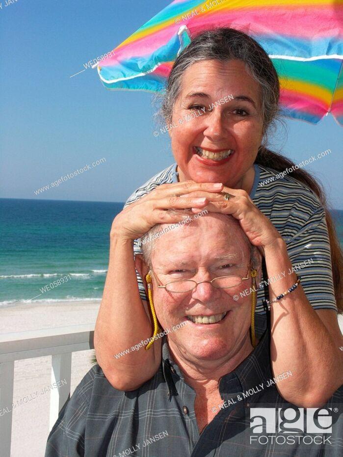 Stock Photo: Happy Couple Having Fun on the Beach.