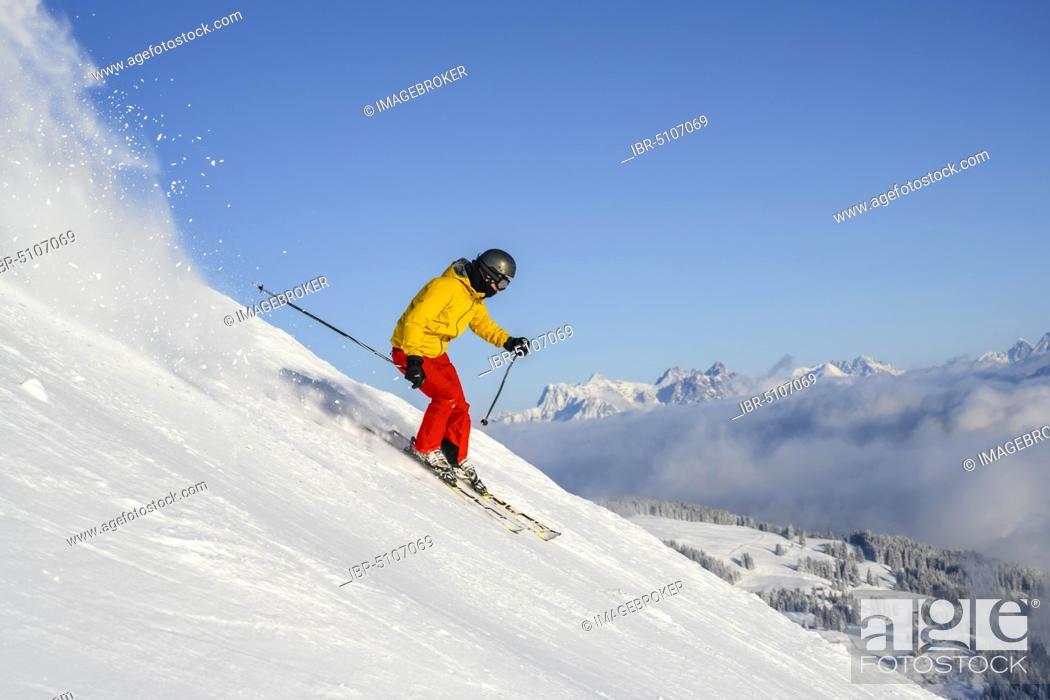 Stock Photo: Skier, Hohe Salve ski run, Loferer Steinberge at the back, Skiwelt Wilder Kaiser Brixenthal, Hochbrixen, Tyrol, Austria, Europe.