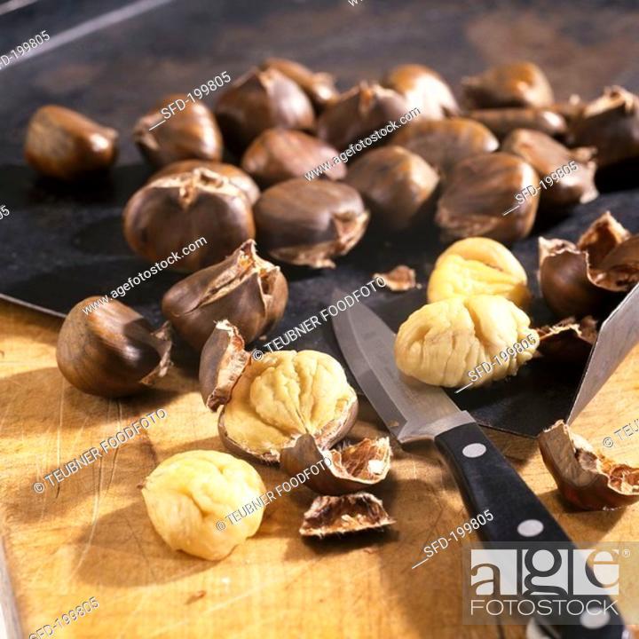 Stock Photo: Sweet chestnuts Castanea sativa, roasted.