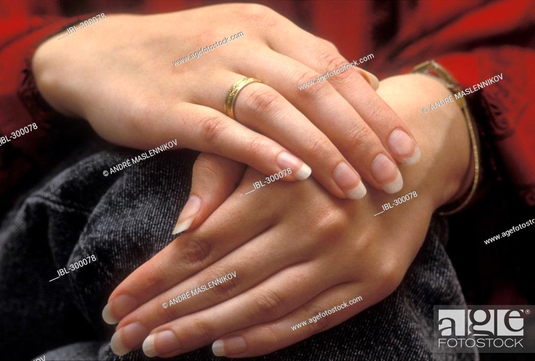 Stock Photo: Hands with engagement ring.