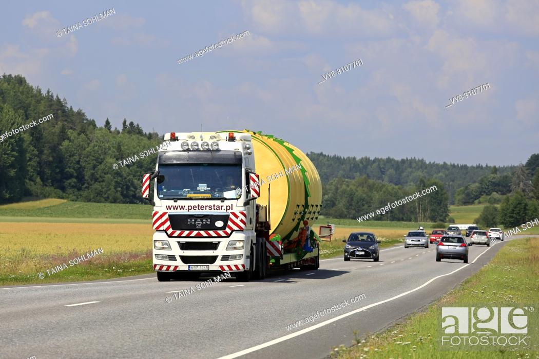 Stock Photo: Wide load transport of a silo by MAN TGX 26. 540 semi trailer of Peter-Star, Poland on the road in South of Finland. Salo, Finland - July 27, 2018.