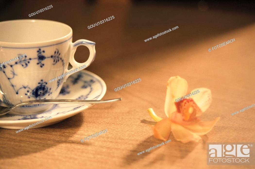 Stock Photo: A Coffee Cup And A Flower.