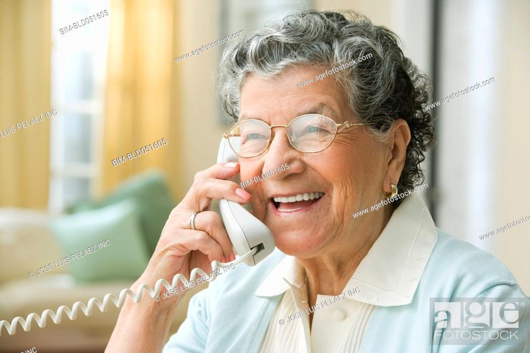 Stock Photo: Senior Hispanic woman talking on cell phone.