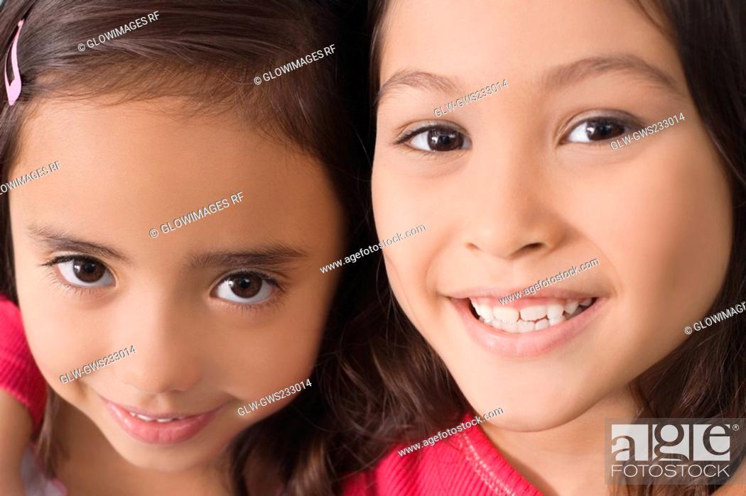 Stock Photo: Portrait of two girls smiling.