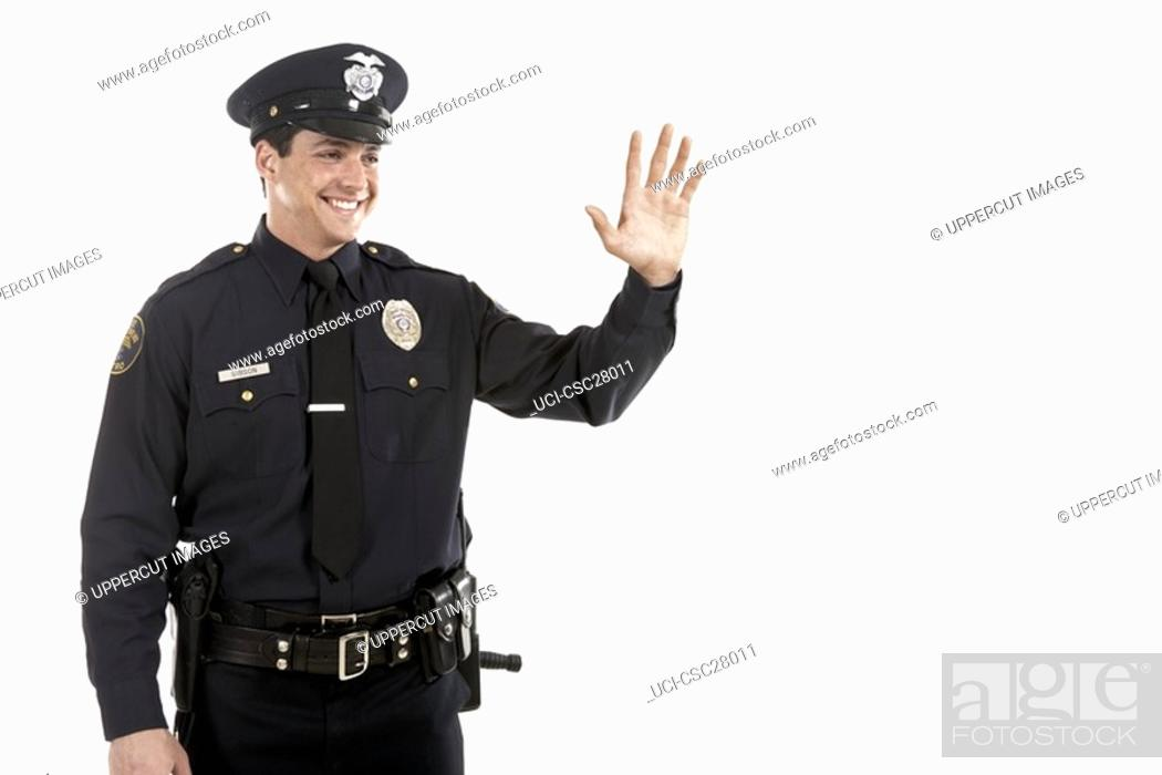 Stock Photo: Male police officer waving.