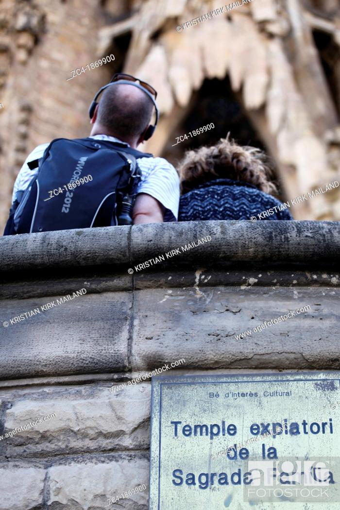 Stock Photo: Tourist looking up La Sagrada Familia, Spain.