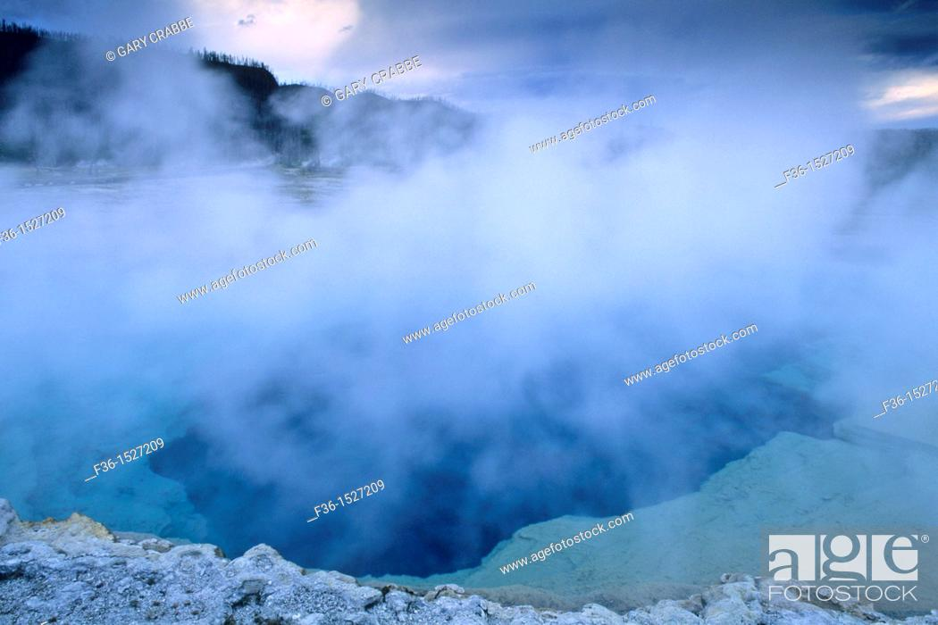 Stock Photo: Steam rising off Sapphire Pool on a stormy evening, Biscuit Basin, Yellowstone National Park, WYOMING.