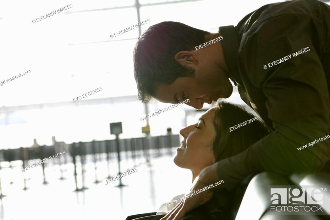 Stock Photo: Young affectionate couple in airport.