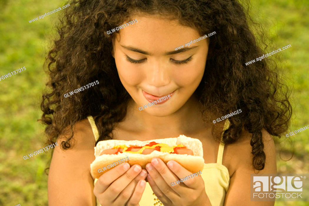 Stock Photo: Close-up of a girl holding a sandwich.