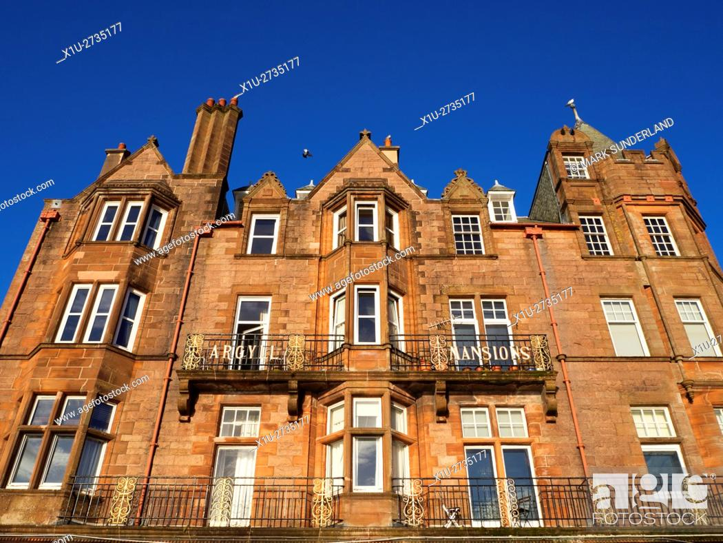 Imagen: Aygyll Mansions Victorian Sandstone Building on the Seafront in Oban Argyll and Bute Scotland.