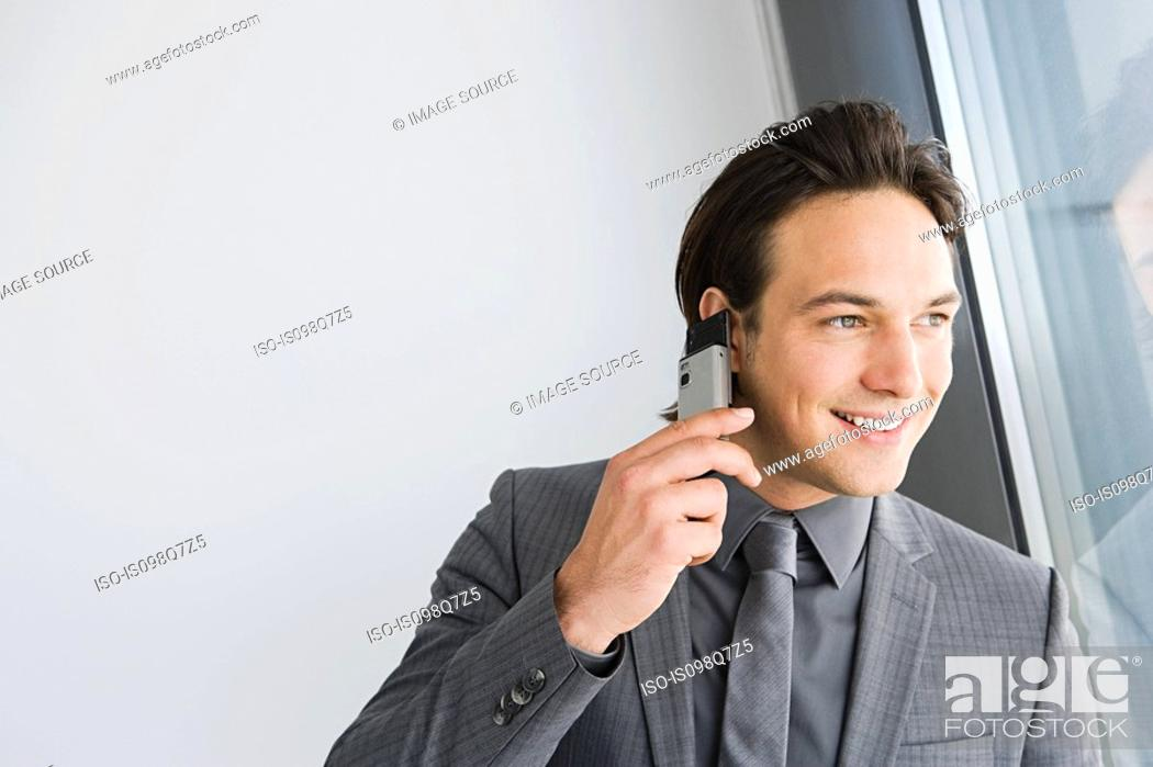 Stock Photo: Businessman on cellphone.