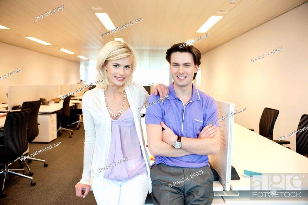 Stock Photo: Business couple smiling in an office.
