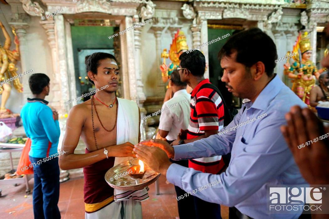 Sri Veeramakaliamman Hindu Temple  Hindu devotees during a morning