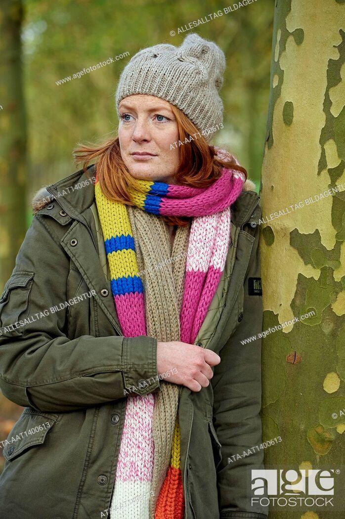 Stock Photo: Pensive woman in autumn.