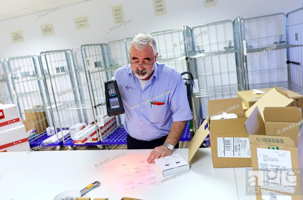 Stock Photo: Man scanning materials with bar codes reader, Warehouse, Hospital Donostia, San Sebastian, Basque Country, Spain.