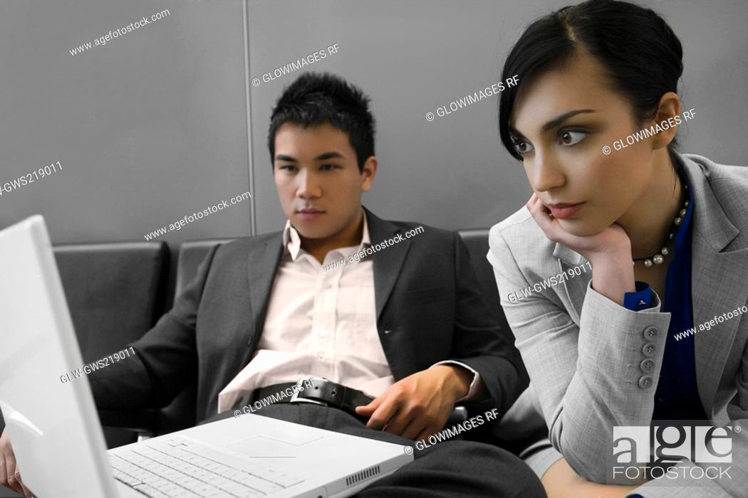 Stock Photo: Businessman and a businessman looking at a laptop.