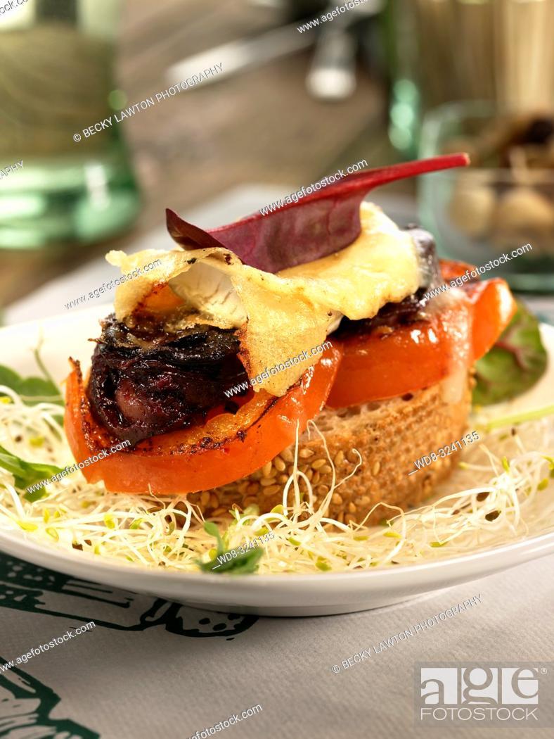 Stock Photo: montadito de morcilla, queso de cabra, tomate y miel.