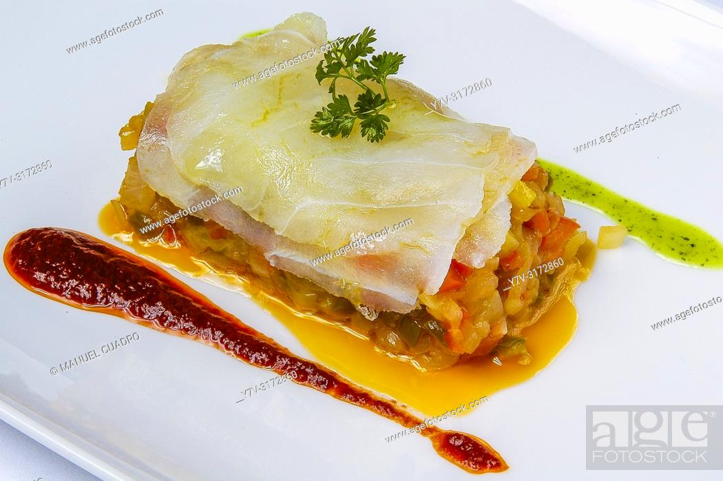 Stock Photo: Rodajas de bacalao a la Riojana con salsa revuelta y pimiento rojo (sliced riojan style cod with sauce and red pepper). Cuisine of La Rioja, Spain.
