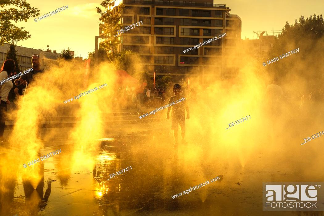 "Stock Photo: Bulgaria, Burgas. Children playing on the main Square ""Troikata"" on a hot summer day."