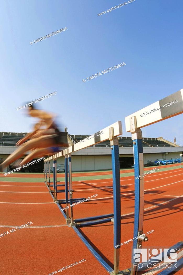 Stock Photo: Hurdlers Hurdling Hurdles.