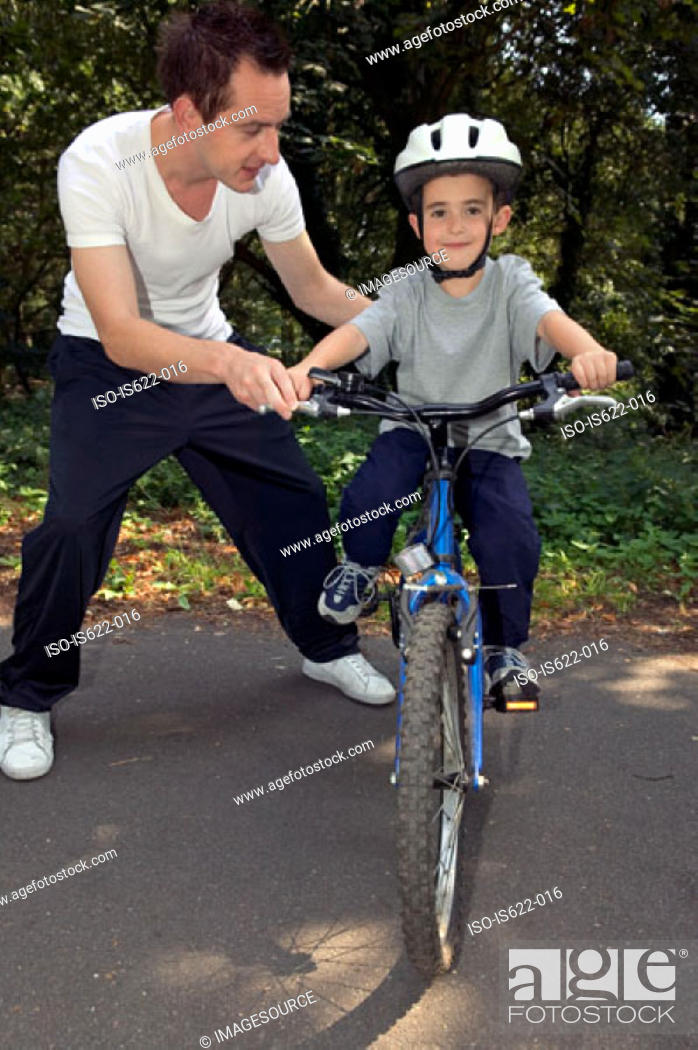 Stock Photo: Boy learning to ride a bike.