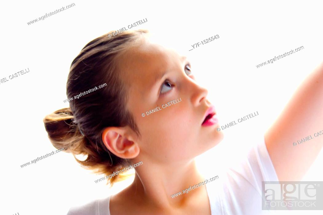 Stock Photo: Portraiture of a young pretty girl dancing.