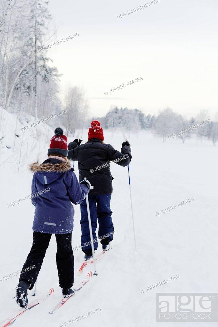 Stock Photo: Girls skiing.