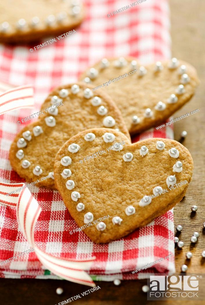 Stock Photo: Heart-shaped cinnamon biscuits for Christmas.