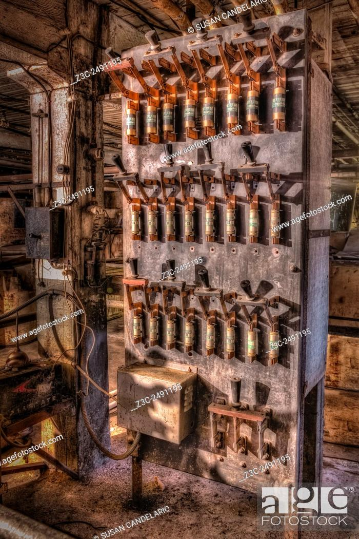 """Stock Photo: Industrial Electrical Panel II - Rusted and no longer cared for but still standing. This electrical circuit panel is from the early 1900""""""""s."""
