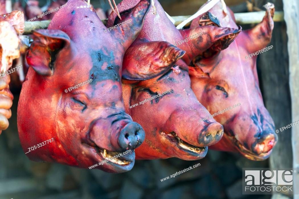 Stock Photo: Pig heads, Khonoma Village, Nagaland, India.
