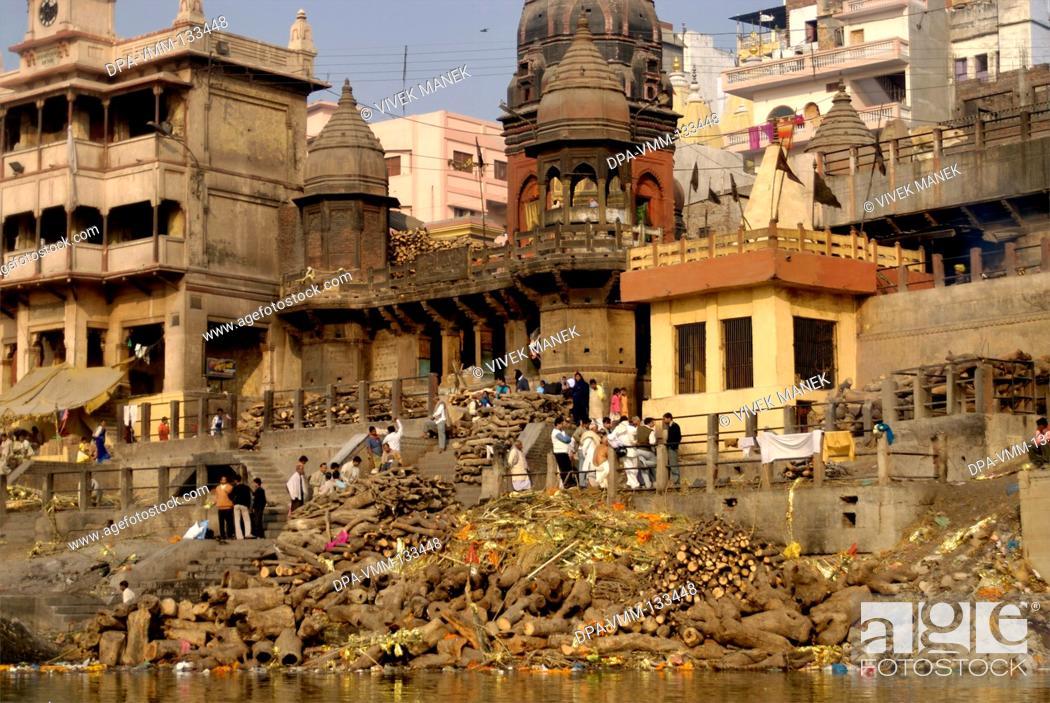 Stock Photo: Hindu cremation ceremony at Manikarnika ghat on banks of holy Ganga river ; Varanasi ; Uttar Pradesh ; India.