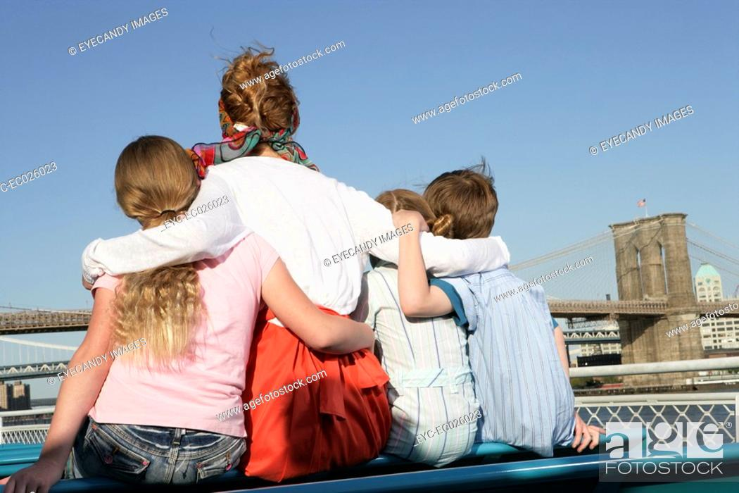 Stock Photo: Back view of a family sitting on a ferry.