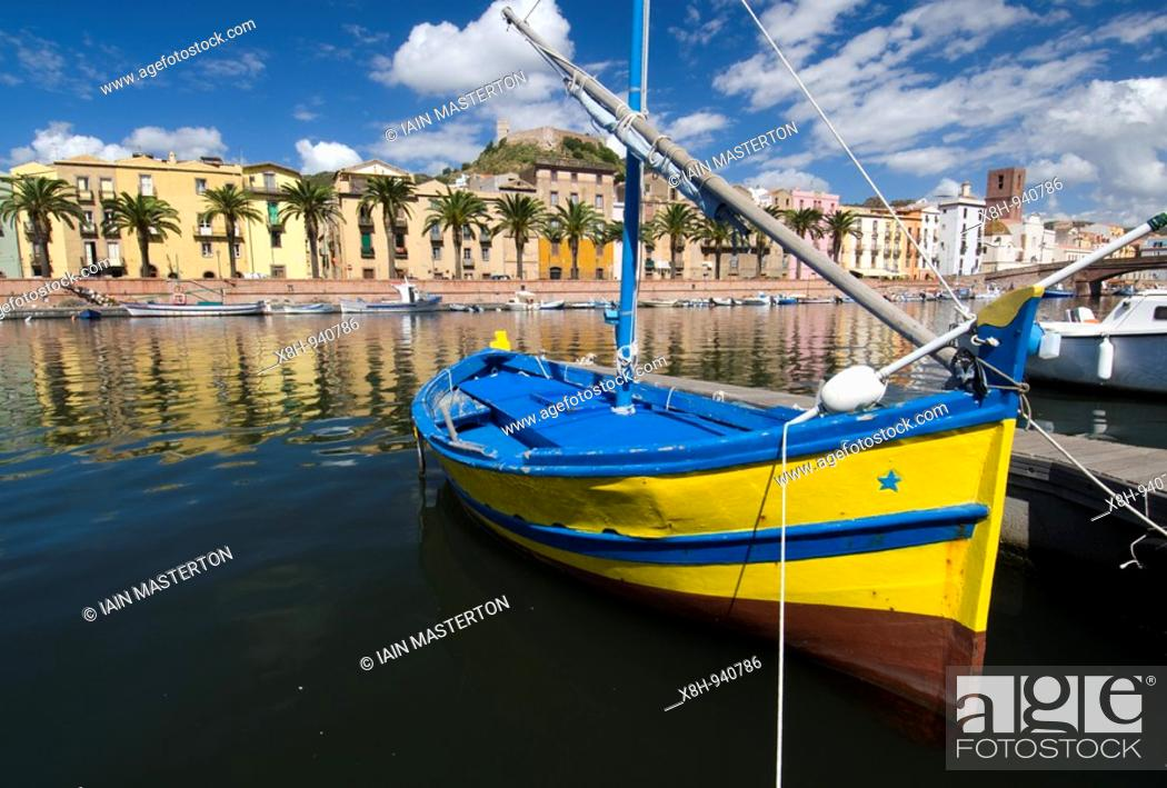 Stock Photo: Small boat on river in centre of Bosa town on Sardinia in Italy.
