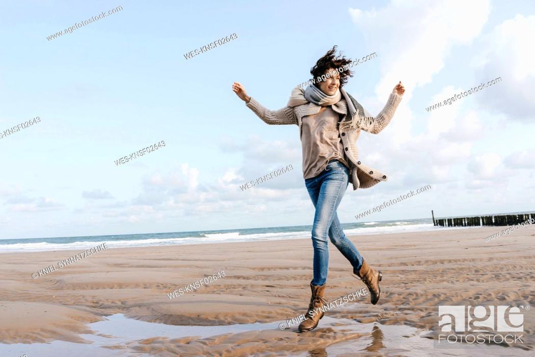 Stock Photo: Happy woman running on the beach.