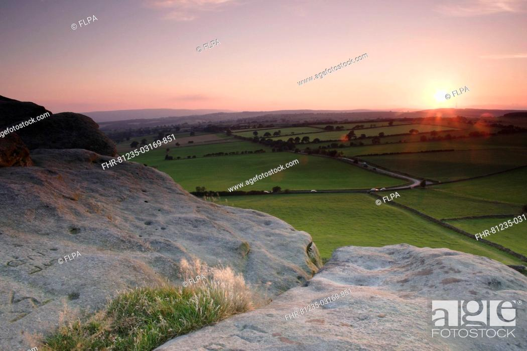 Stock Photo: View over surrounding farmland from Almscliff Crag rock formation at sunset, North Rigton, North Yorkshire, England, august.